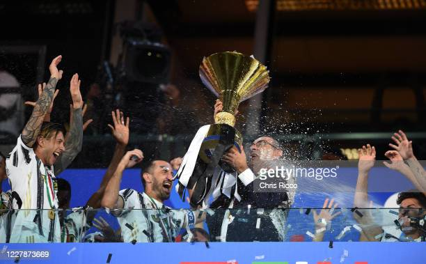 Federico Bernardeschi of Juventus , Giorgio Chiellini of Juventus and Maurizio Sarri, Manager of Juventus celebrate with the trophy after winning the...