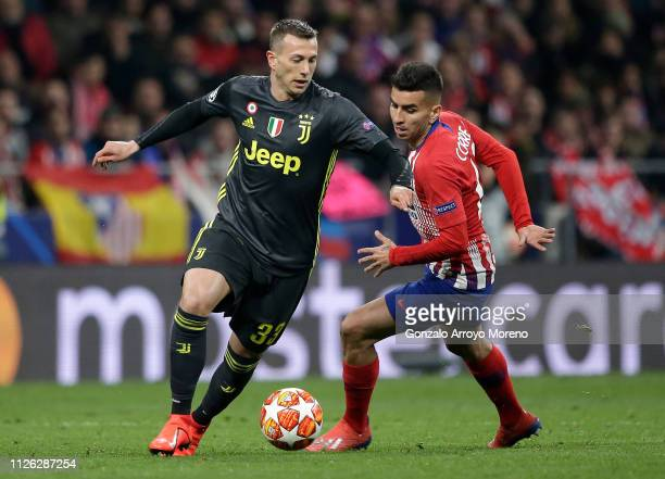 Federico Bernardeschi of Juventus is challenged by Angel Correa of Atletico Madrid during the UEFA Champions League Round of 16 First Leg match...