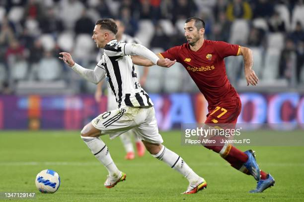 Federico Bernardeschi of Juventus is challenged by Henrikh Mkhitaryan of AS Roma during the Serie A match between Juventus and AS Roma at Allianz...