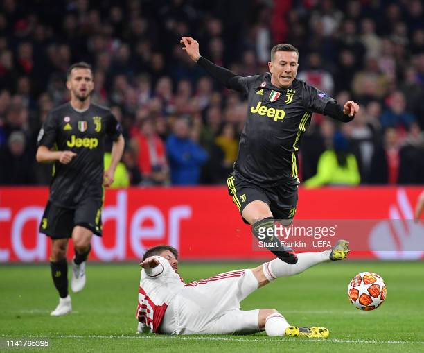 Federico Bernardeschi of Juventus is challenged by Lasse Schöne of Ajax during the UEFA Champions League Quarter Final first leg match between Ajax...