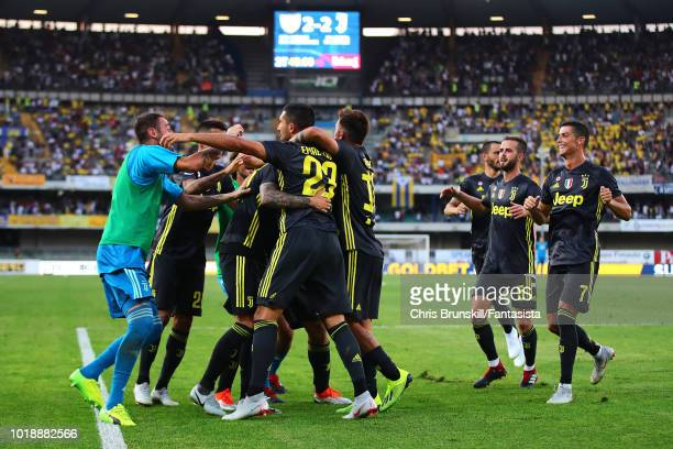 Federico Bernardeschi of Juventus is mobbed by his team-mates after scoring his side's third goal during the Serie A match between Chievo Verona and...