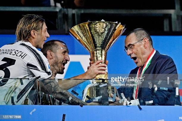 Federico Bernardeschi of Juventus, Leonardo Bonucci of Juventus, coach Maurizio Sarri of Juventus celebrates the championship with the trophy during...