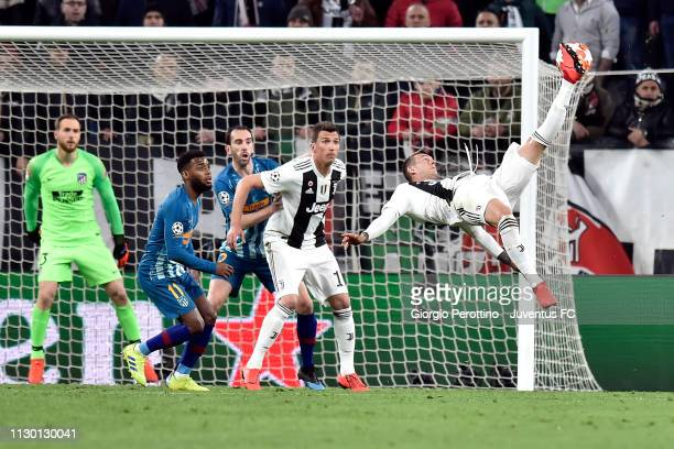 Federico Bernardeschi of Juventus shoots the ball on overturned during the UEFA Champions League Round of 16 Second Leg match between Juventus and...