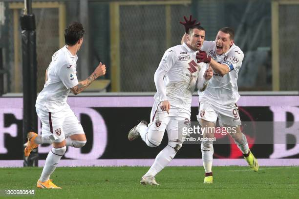 Federico Bonzzoli of Torino FC celebrates with team mate Andrea Belotti after scoring their side's third goal during the Serie A match between...