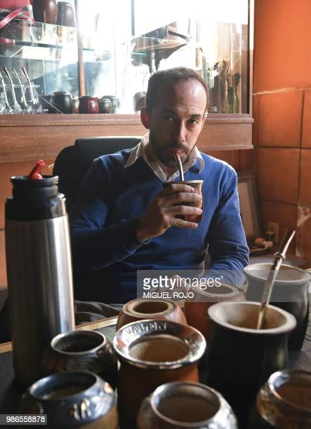 Federico Bresciani owner of traditional handmade silverware store Bresciani drinks mate at his workshop in Montevideo on June 27 2018 Several players...