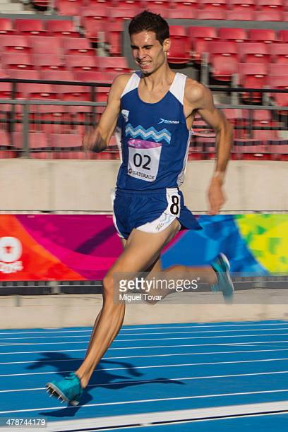 Federico Bruno of Argentina leads in Men's 1500m during day eight of the X South American Games Santiago 2014 at Estadio Nacional de Santiago on...