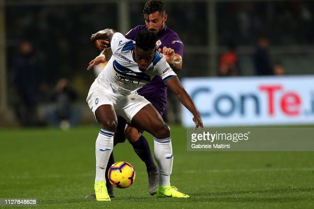 Federico Ceccherini of ACF Fiorentina battles for the ball with Duvan Zapata of Atalanta BC during the Coppa Italia match between ACF Fiorentina and...