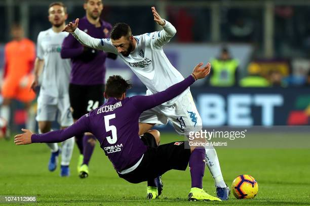 Federico Ceccherini of ACF Fiorentina battles for the ball with Francesco Caputo of Empoli FC during the Serie A match between ACF Fiorentina and...