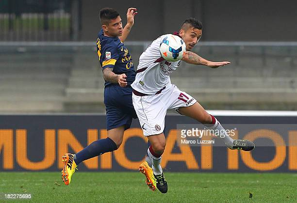 Federico Ceccherini of AS Livorno competes for the ball with Arevalos Juan Manuel Iturbe of Hellas Verona FC during the Serie A match between Hellas...