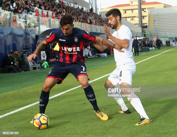 Federico Ceccherini of Crotone competes for the ball with Marco Benassi of Fiorentina during the Serie A match between FC Crotone and ACF Fiorentina...