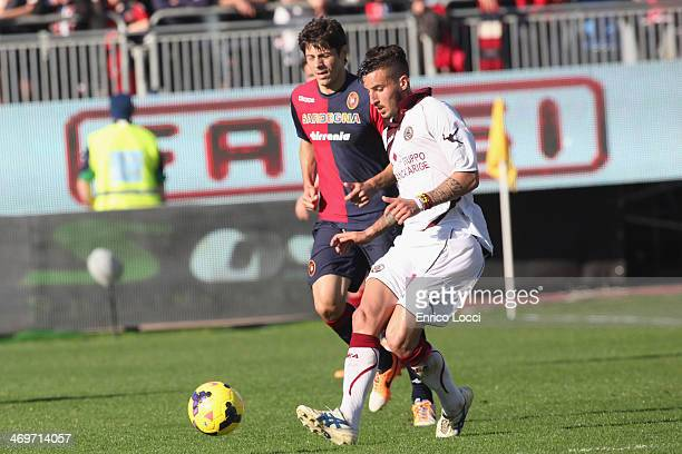 Federico Ceccherini of Livorno competes with Nene of Cagliari during the Serie A match between Cagliari Calcio and AS Livorno Calcio at Stadio...