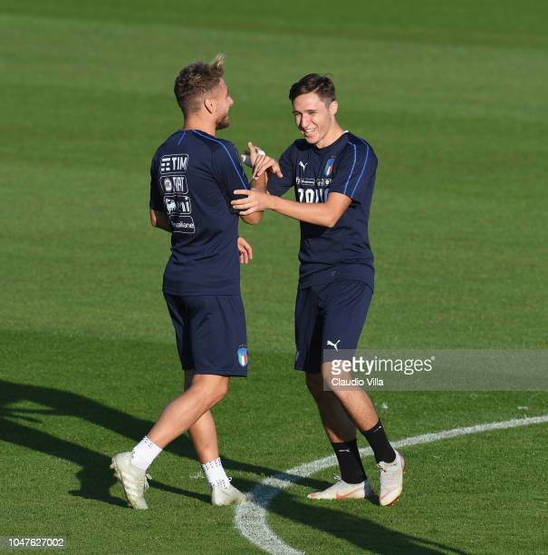 Federico Chiesa and Ciro Immobile of Italy in action during a Italy training session at Centro Tecnico Federale di Coverciano on October 8 2018 in...