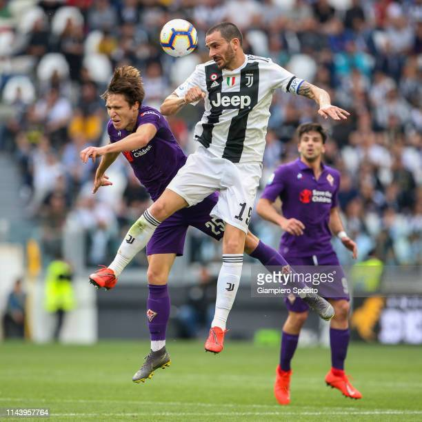 Federico Chiesa of ACF Fiorentina and Leonardo Bonucci of Juventus jump for the ball during the Serie A match between Juventus and ACF Fiorentina on...
