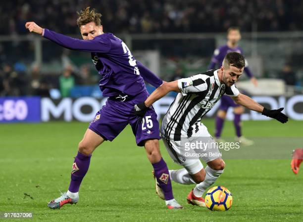Federico Chiesa of ACF Fiorentina and Miralem Pjanic of Juventus in action during the serie A match between ACF Fiorentina and Juventus at Stadio...