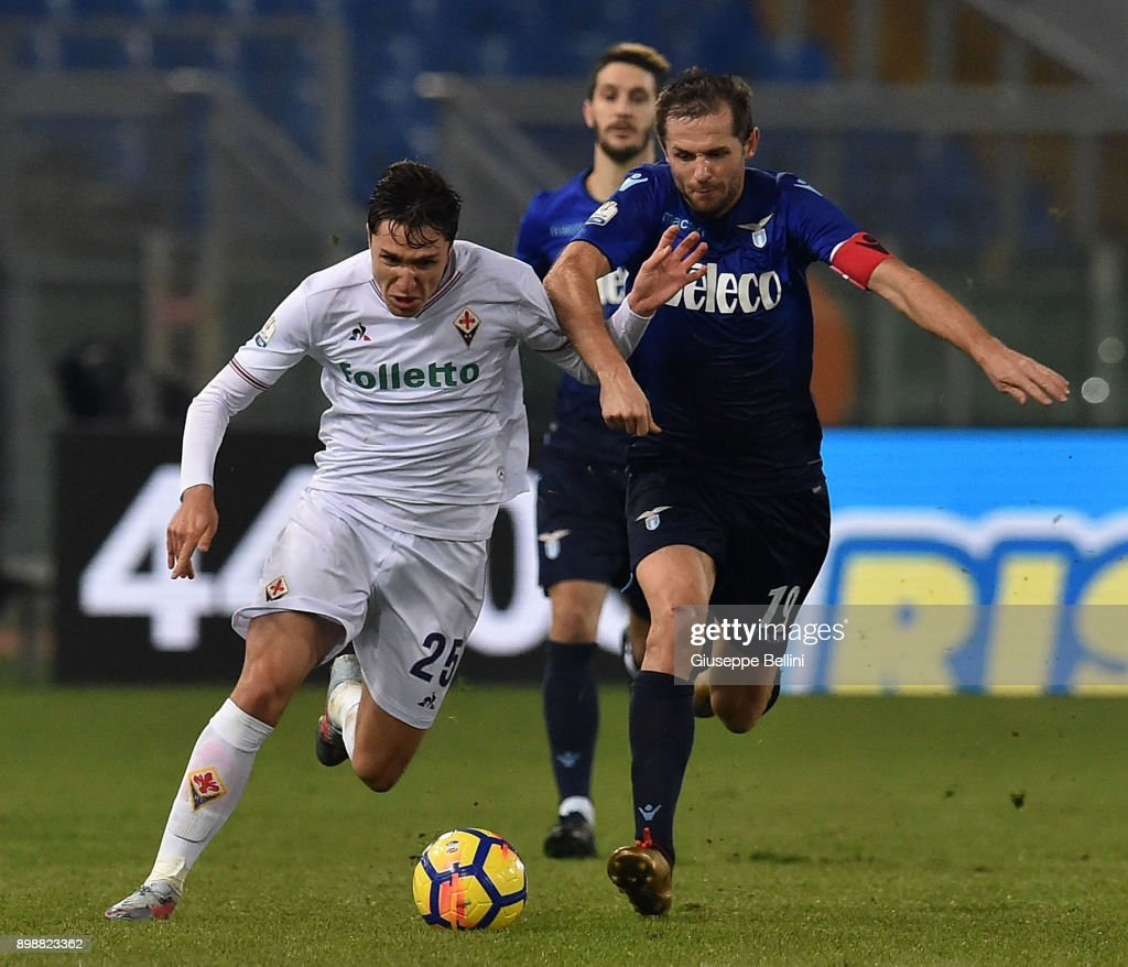 Federico Chiesa of ACF Fiorentina and Senad Lulic of SS Lazio in action during the TIM Cup match between SS Lazio and ACF Fiorentina at Olimpico Stadium on December 26, 2017 in Rome, Italy.