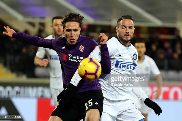 Federico Chiesa of ACF Fiorentina battles for the ball with Danilo D'Ambrosio of FC Internazionale during the Serie A match between ACF Fiorentina...
