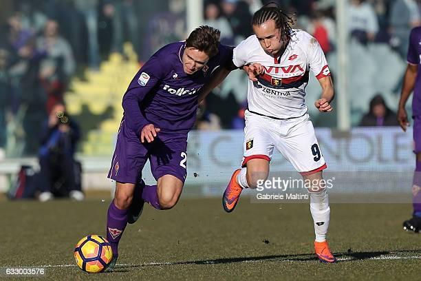 Federico Chiesa of ACF Fiorentina battles for the ball with Diego Laxalt of Genoa CFC during the Serie A match between ACF Fiorentina and Genoa CFC...