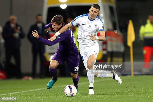 Federico Chiesa of ACF Fiorentina battles for the ball with Jan Sykora of FC Slovan Liberec during the UEFA Europa League match between ACF...