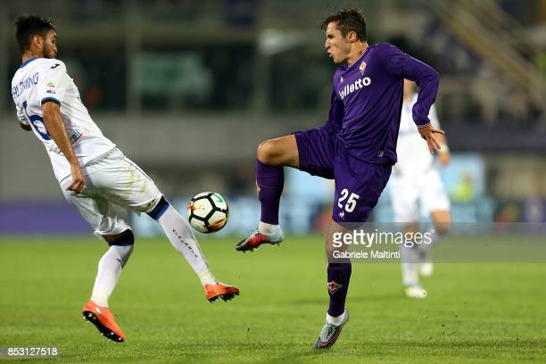 Federico Chiesa of ACF Fiorentina battles for the ball with Jose' Palomino of Atalanta BC during the Serie A match between FC Crotone and Benevento...