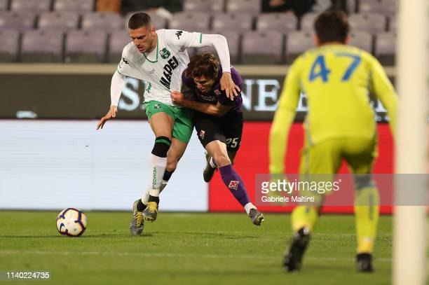 Federico Chiesa of ACF Fiorentina battles for the ball with Merhil Demiral of US Sassuolo during the Serie A match between ACF Fiorentina and US...