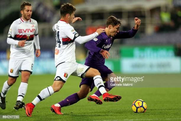 Federico Chiesa of ACF Fiorentina battles for the ball with Miguel Veloso of Genoa CFC during the Serie A match betweenACF Fiorentina and Genoa CFC...
