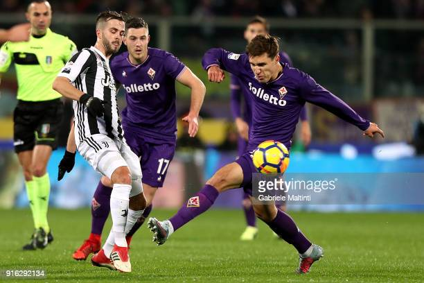 Federico Chiesa of ACF Fiorentina battles for the ball with Miralem Pjanic of Juventus during the serie A match between ACF Fiorentina and Juventus...
