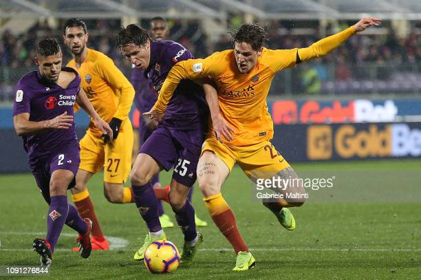 Federico Chiesa of ACF Fiorentina battles for the ball with Nicolo' Zaniolo of AS Roma during the Coppa Italia match between ACF Fiorentina and AS...