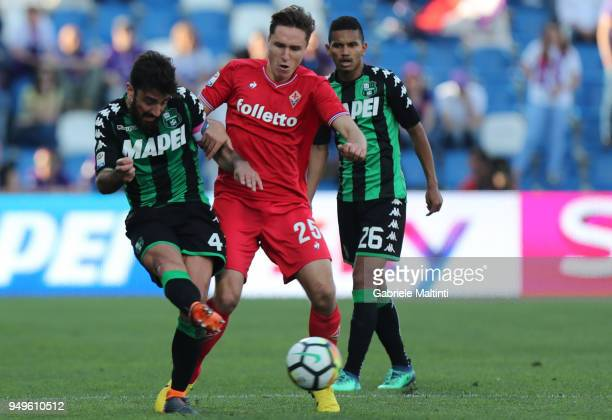 Federico Chiesa of ACF Fiorentina battles for the ball with Freancesco Magnanelli of US Sassuolo during the serie A match between US Sassuolo and ACF...