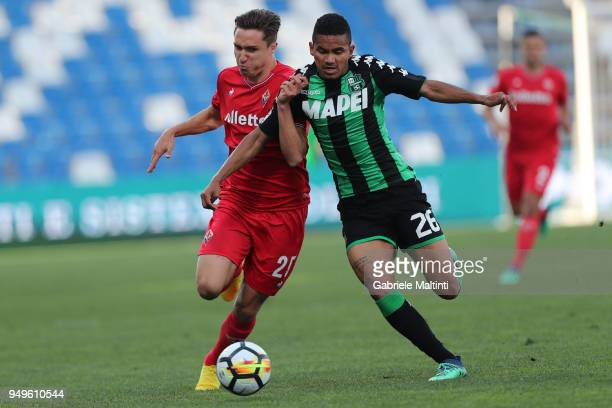 Federico Chiesa of ACF Fiorentina battles for the ball with Rogerio of US Sassuolo during the serie A match between US Sassuolo and ACF Fiorentina at...