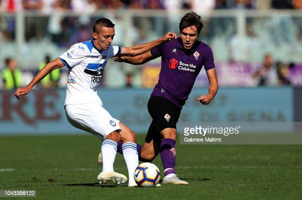 Federico Chiesa of ACF Fiorentina battles for the ball with Timothy Castagne of Atalanta BC during the Serie A match between ACF Fiorentina and...