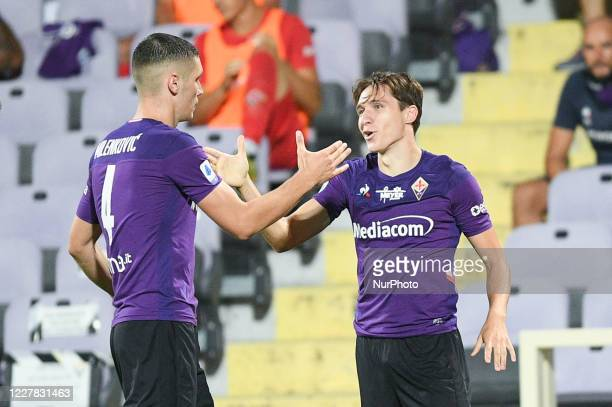 Federico Chiesa of ACF Fiorentina celebrates with his teammates scoring first goal during the Serie A match between ACF Fiorentina and Bologna FC at...