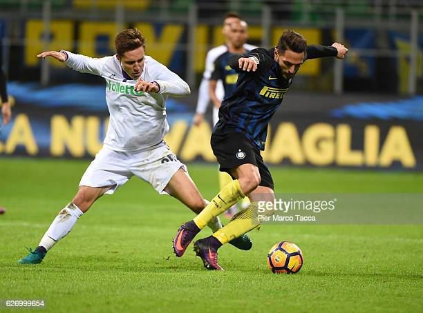 Federico Chiesa of ACF Fiorentina competes for the ball with Danilo D'Ambrosio of FC Internazionale during the Serie A match between FC...