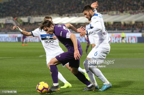 Federico Chiesa of ACF Fiorentina competes for the ball with José Luis Palomino of Atalanta during the Coppa Italia match between ACF Fiorentina and...