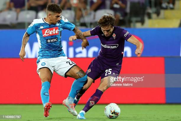 Federico Chiesa of ACF Fiorentina fights for the ball with Giovanni Di Lorenzo of SSC Napoli during the Serie A match between ACF Fiorentina and SSC...