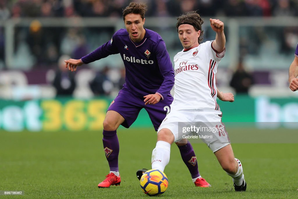 Federico Chiesa of ACF Fiorentina fights for the ball with Riccardo Montolivo of AC Milan during the serie A match between ACF Fiorentina and AC Milan at Stadio Artemio Franchi on December 30, 2017 in Florence, Italy.