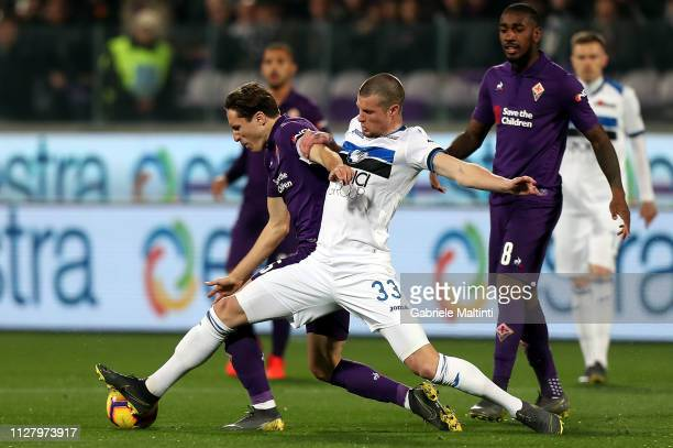 Federico Chiesa of ACF Fiorentina in action against Hans Hateboer of Atalanta BC during the Coppa Italia match between ACF Fiorentina and Atalanta BC...
