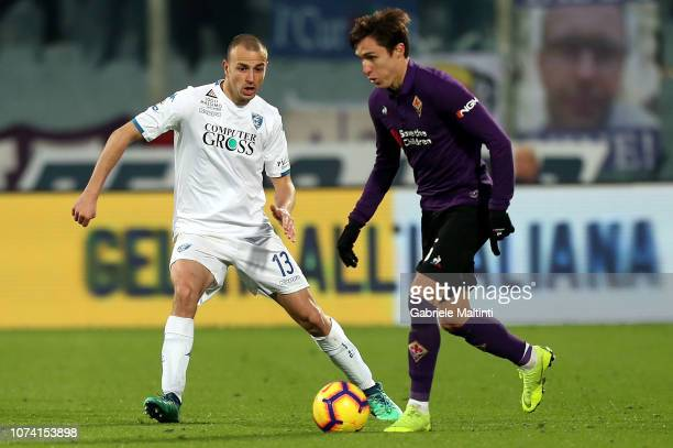 Federico Chiesa of ACF Fiorentina in action against Luca Antonelli of Empoli FC during the Serie A match between ACF Fiorentina and Empoli at Stadio...
