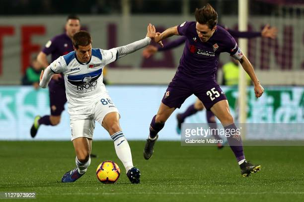 Federico Chiesa of ACF Fiorentina in action against Mario Pasalic during the Coppa Italia match between ACF Fiorentina and Atalanta BC on February 27...