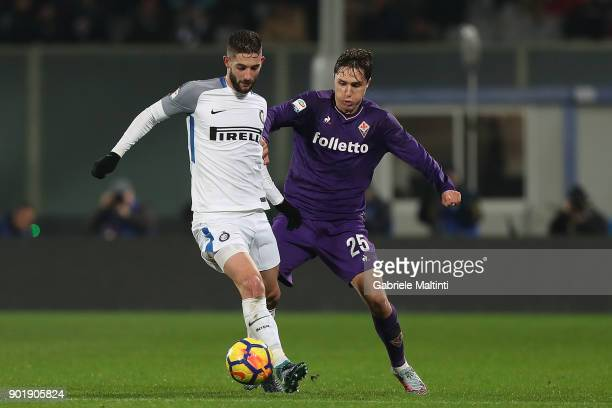 Federico Chiesa of ACF Fiorentina in action against Roberto Gagliardini of FC Internazionale during the serie A match between ACF Fiorentina and FC...