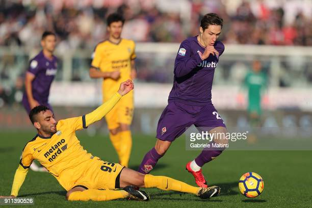 Federico Chiesa of ACF Fiorentina in action against Samuel Souprayen of Hellas Verona FC during the serie A match between ACF Fiorentina and Hellas...
