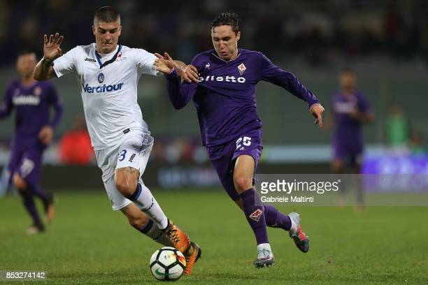 Federico Chiesa of ACF Fiorentina in action agaist Gianluca Mancini of Atalanta BC during the Serie A match between FC Crotone and Benevento Calcio...
