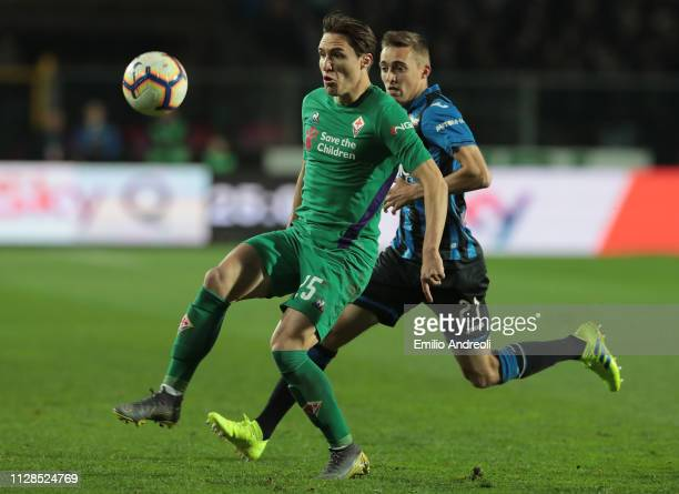 Federico Chiesa of ACF Fiorentina is challenged by Timothy Castagne of Atalanta BC during the Serie A match between Atalanta BC and ACF Fiorentina at...