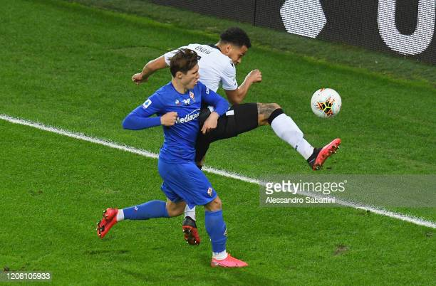 Federico Chiesa of Fiorentina ACF competes for the ball with William Ekong of Udinese Calcio during the Serie A match between Udinese Calcio and ACF...