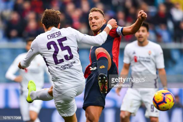Federico Chiesa of Fiorentina and Domenico Criscito of Genoa vie for the ball during the Serie A match between Genoa CFC and ACF Fiorentina at Stadio...
