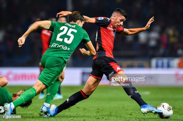Federico Chiesa of Fiorentina and Paolo Ghiglione of Genoa during the Serie A match between Genoa CFC and ACF Fiorentina at Stadio Luigi Ferraris on...
