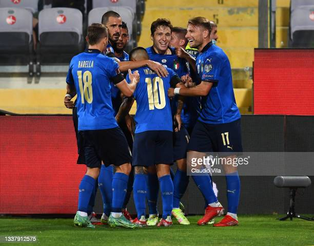 Federico Chiesa of Italy celebrate with team-mates after scoring the opening goal during the 2022 FIFA World Cup Qualifier match between Italy and...