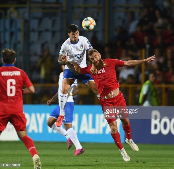 Federico Chiesa of Italy competes for the ball with Alek'sandr Karapetyan of Armenia during the UEFA Euro 2020 qualifier between Armenia and Italy at...