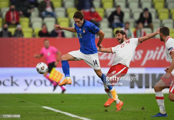 Federico Chiesa of Italy competes for the ball with Bartosz Bereszynski of Poland during the UEFA Nations League group stage match between Poland and...
