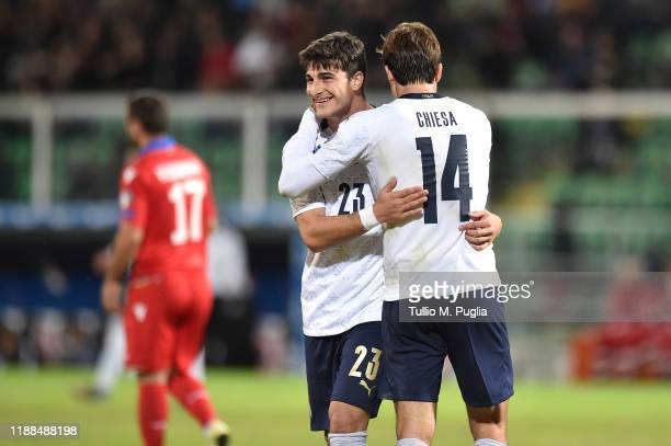 Federico Chiesa of Italy hugs his team mate Riccardo Orsolini during the UEFA Euro 2020 Qualifier between Italy and Armenia on November 18 2019 in...