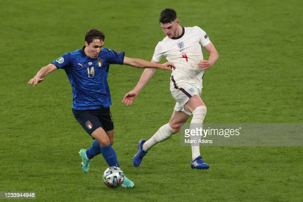 Federico Chiesa of Italy in action with Declan Rice of England during the UEFA Euro 2020 Championship Final between Italy and England at Wembley...